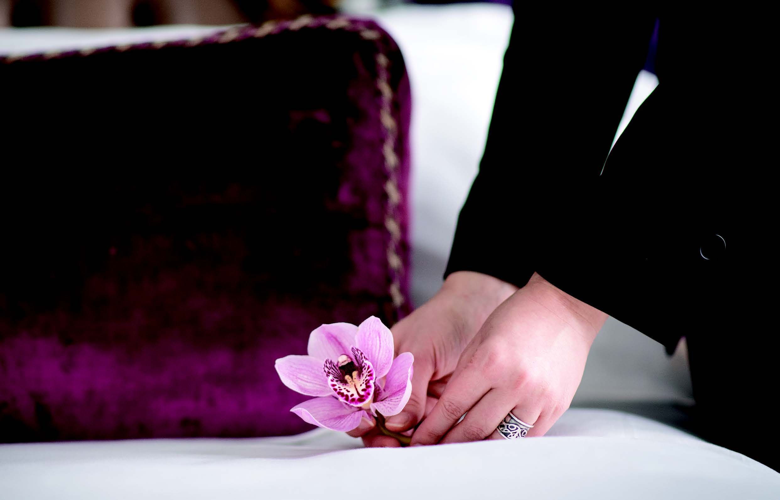 butler laying flower on bed