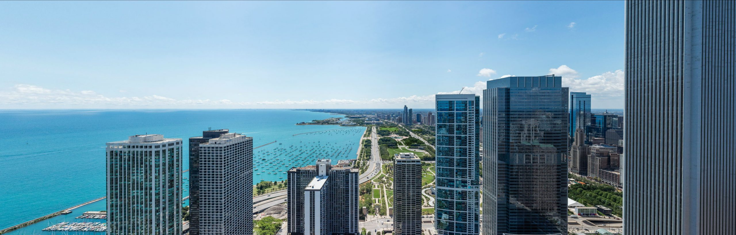 landscape photos of lakeshore east towers and Lake Michigan