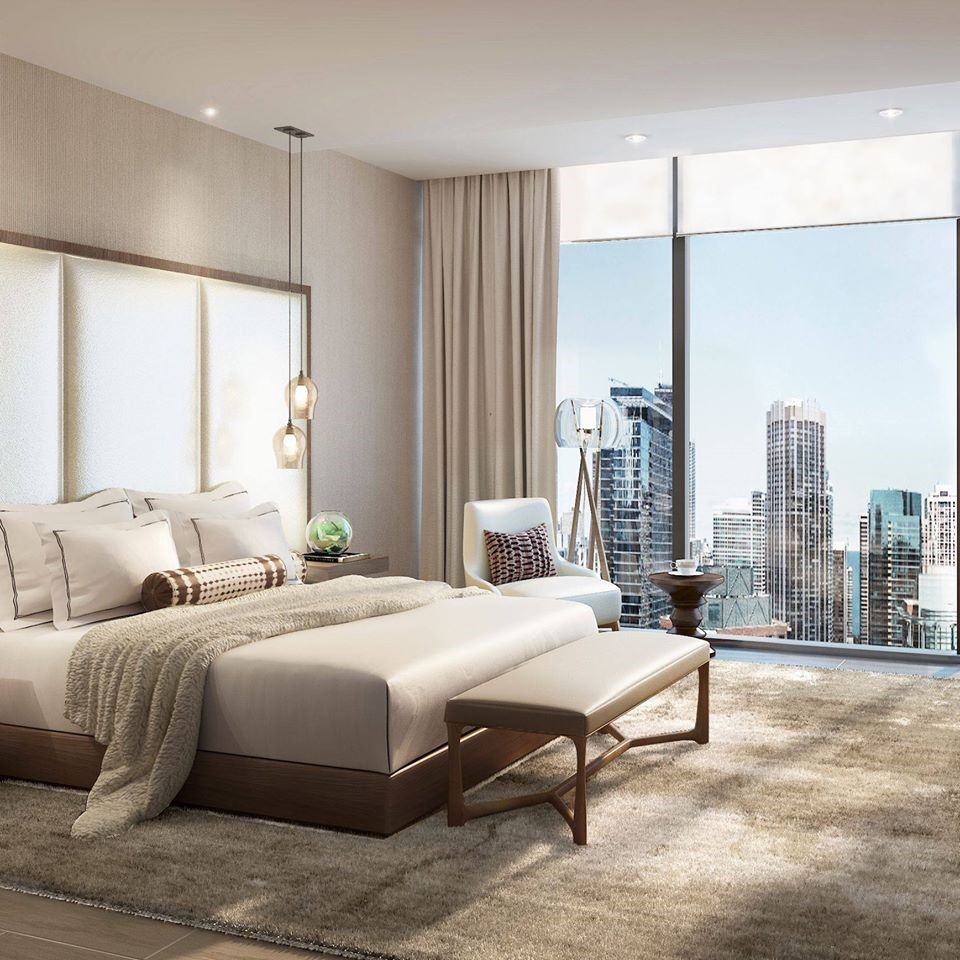 Rendering of Vista Tower condos master bedroom with beige and brown color tones and floor-to-ceiling windows