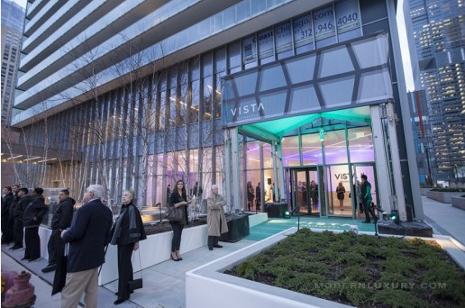 Image of celebration at Vista Tower Sales Gallery Opening celebrating Vista Tower construction progress and condo sales