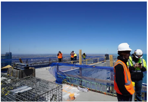 Vista Tower construction crew documents documents laying the last beam in 2019