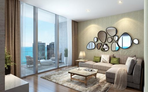 Image of living room in Vista Tower residence with large sofa and architectural elements on the wall